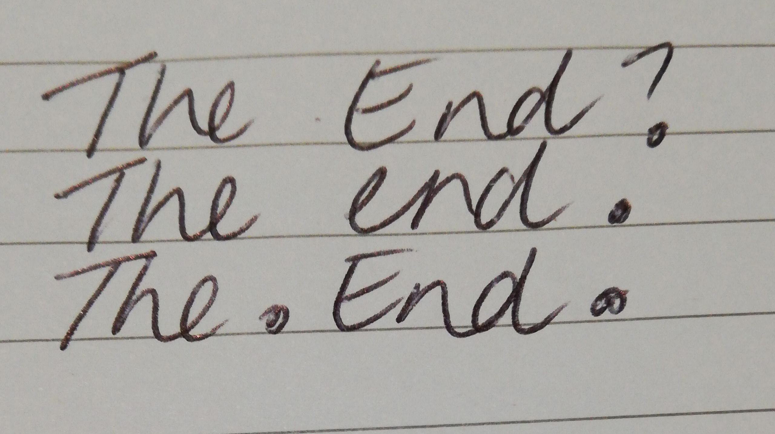 A little something about endings. The picture shows a lined page that reads; The End. The End? The. End.