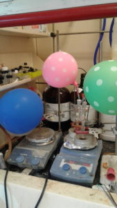 Happier times in the lab: Balloons and lab equipment.