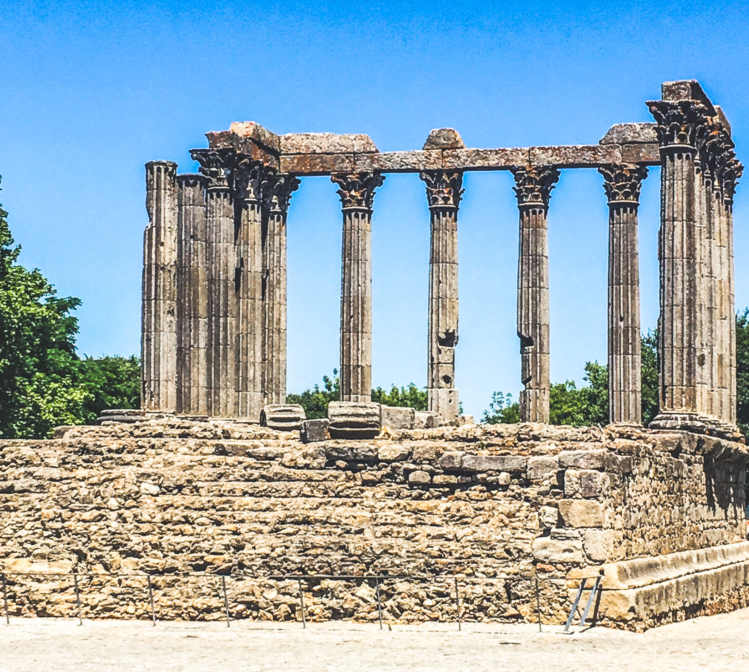 It's not Greek, exactly. But it makes you think of ancient times, no? Picture of some Roman Ruins - The Temple of Evora in Portugal