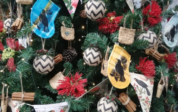 Merry Christmas! Picture shows some festive baubles hanging on a tree