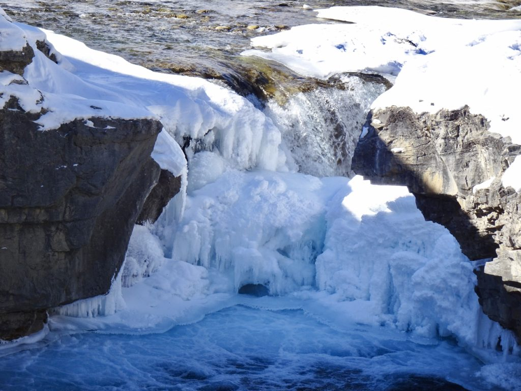 The waterfall behind this wall of ice has carved it's own path, and it is not waiting for anything.