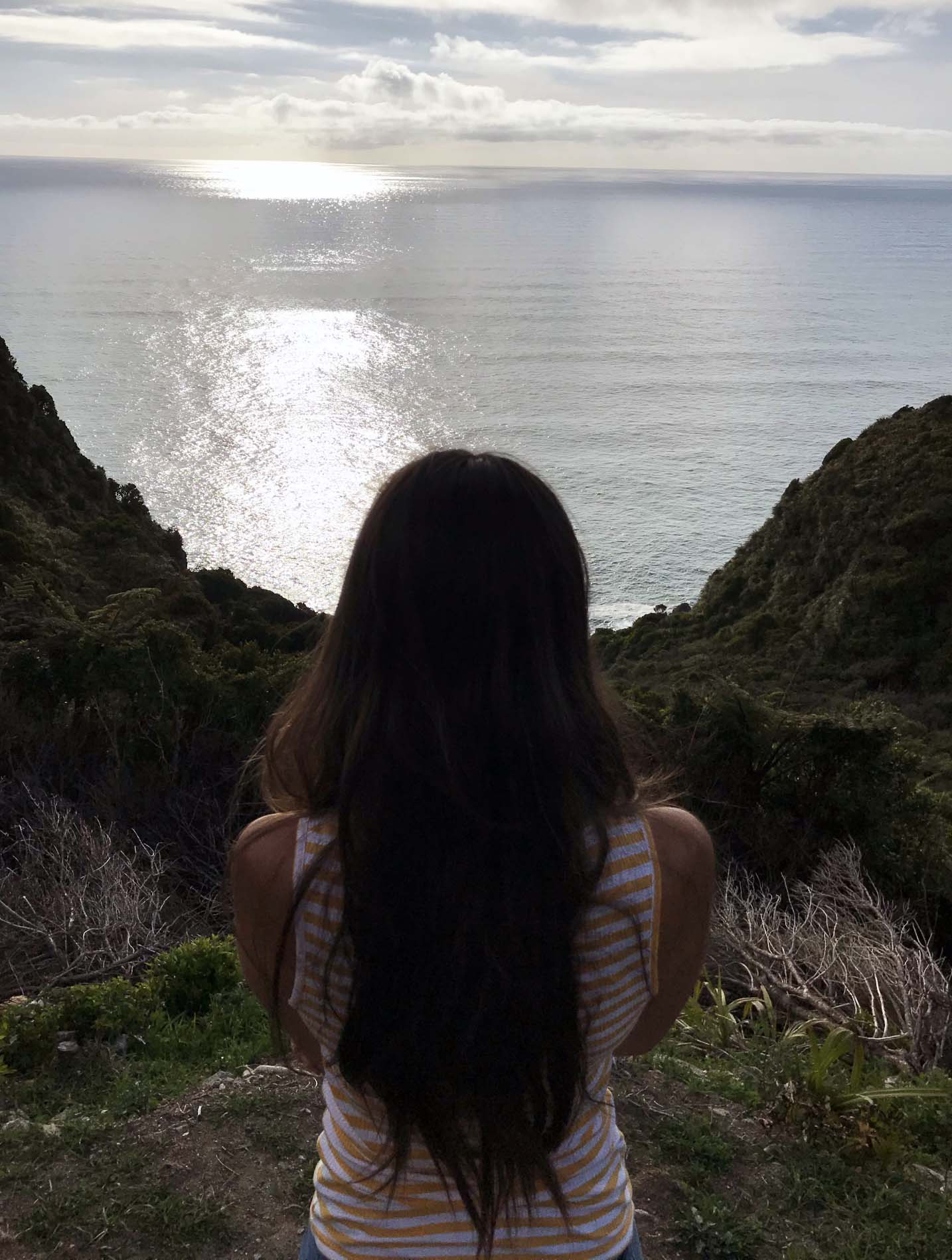 It took a break away from everyday life for Ashley to overcome burnout and continue writing. In the photo, Ashley stares out at the sea.