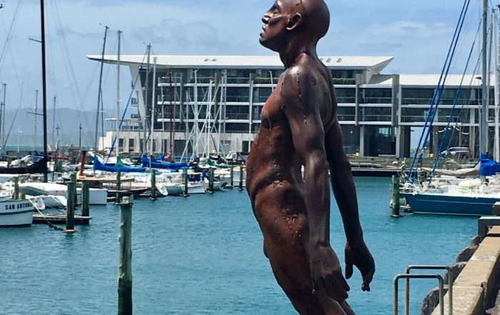 Sometimes fighting covid-19 feels a bit like this statue in Wellington Harbour: leaning into the wind and hoping you're not going to fall. Getting vaccinated is our only safety net right now.
